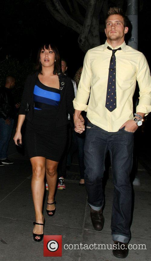 Cheryl Burke with a mystery man Celebrities arrive...