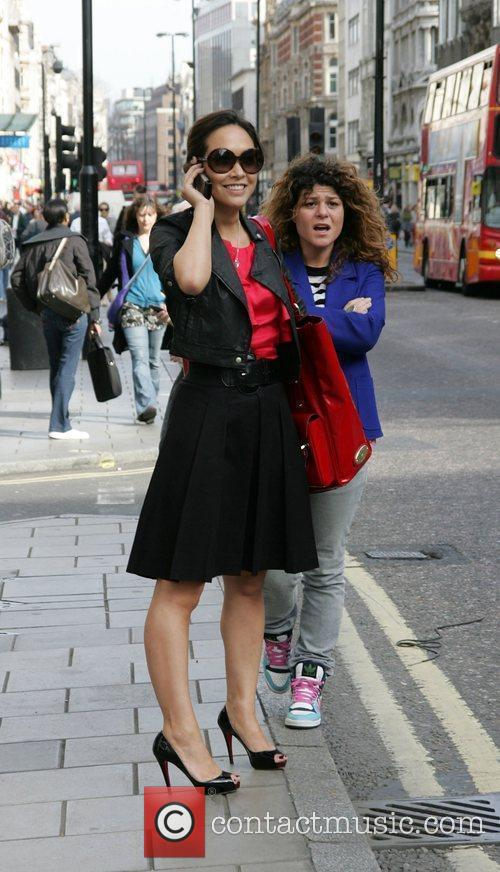 Myleene Klass hailing a taxi on Oxford Street...