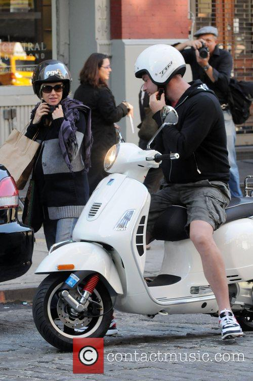 Liev Schreiber and Naomi Watts riding on his...
