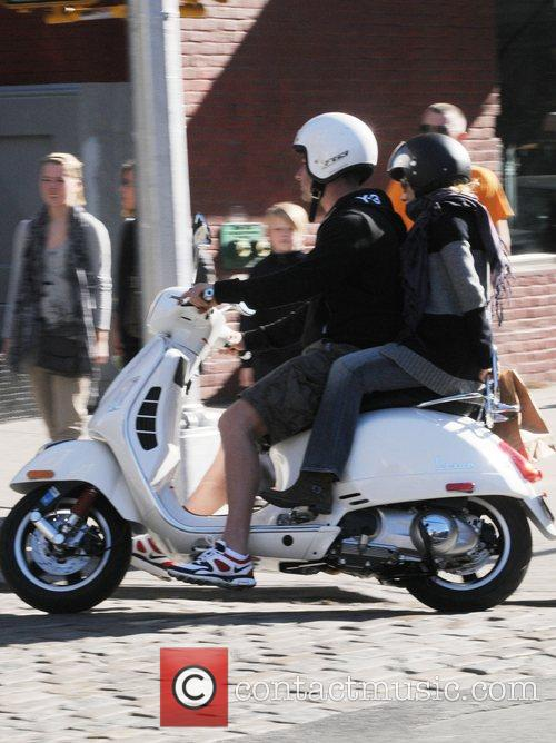 Liev Schreiber and Naomi Watts riding on their...