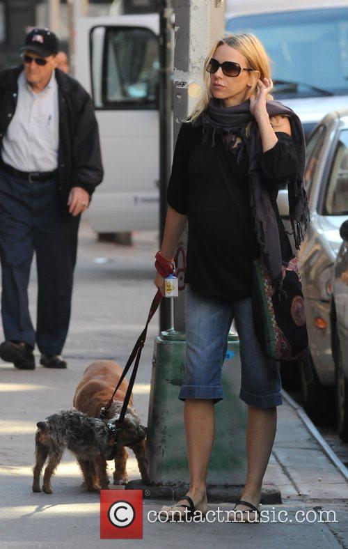 Walking her dogs in Soho.