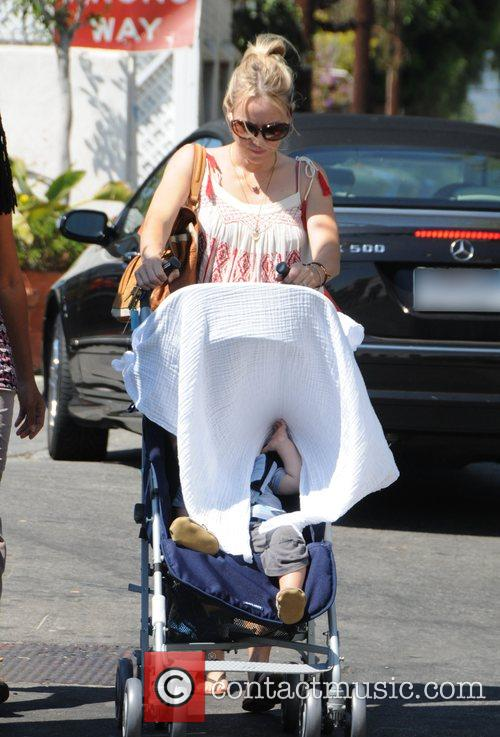 Naomi Watts covers the face of her son...
