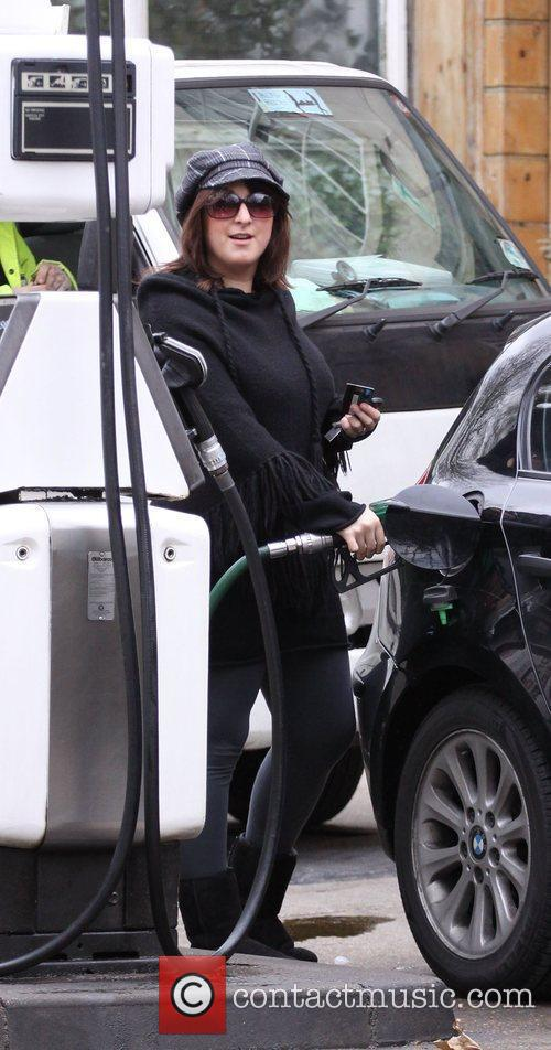 Natalie Cassidy pays for her parking at a...