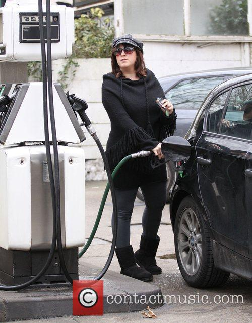 Natalie Cassidy fills her car with petrol London,...