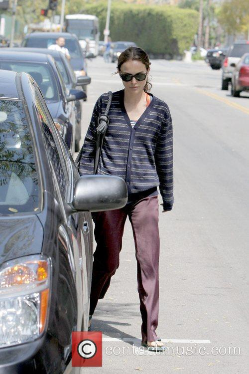 Returns to her car after leaving an office...