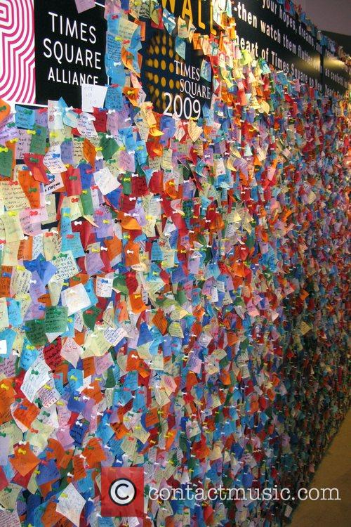 Written wishes of people on bits of colour...