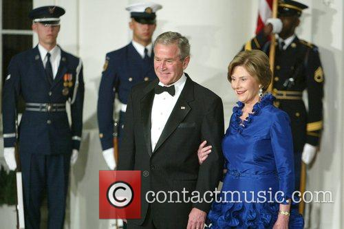 President George W. Bush and First Lady Laura...