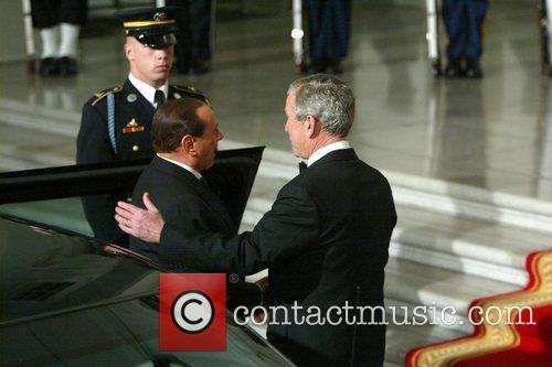 President George W. Bush and Prime Minister Silvio...