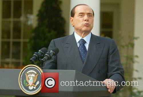President Bush and Italian Prime Minister Berlusconi give...