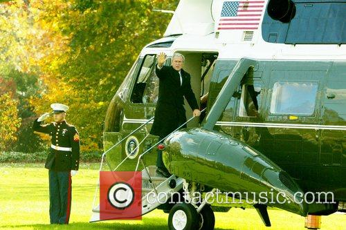 President George W. Bush  boards his helicopter...