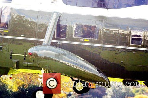 On his helicopter to attend to official business...