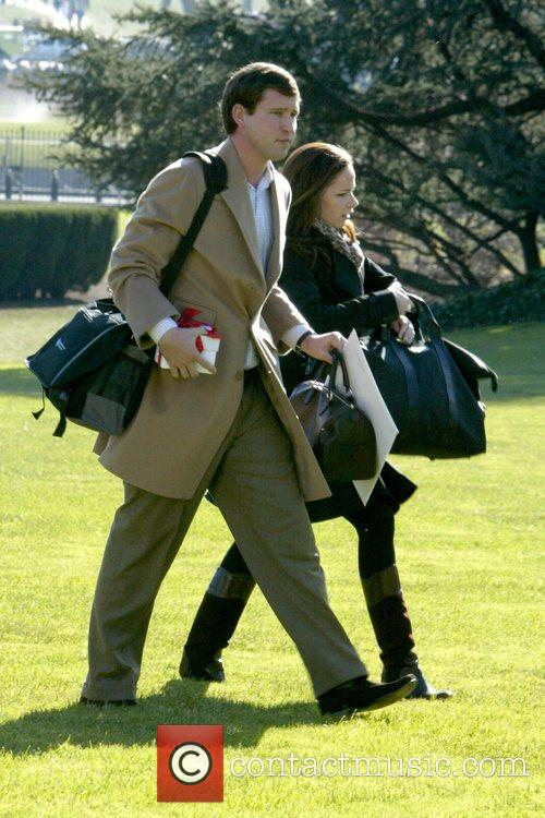 President George W. Bush returns from Camp David...
