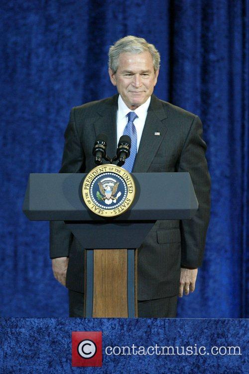 US President George W. Bush unveils his portrait...