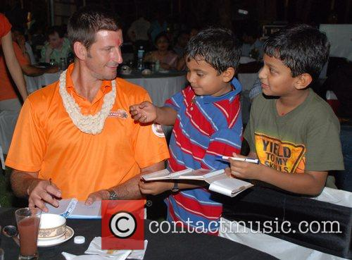Michael Kasprowicz of Mumbai Champs gives an autograph...