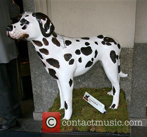 Thirty life-size, fiberglass dogs painted for Green Chimneys'...