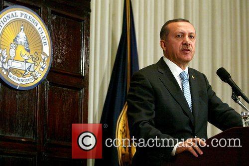 Prime Minister of Turkey Recep Tayyip Erdogan discusses...