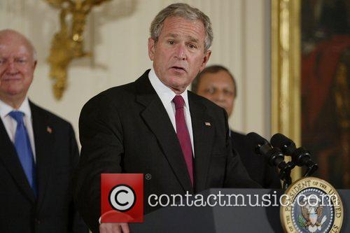 US President George W Bush signs H.R. 7081,...