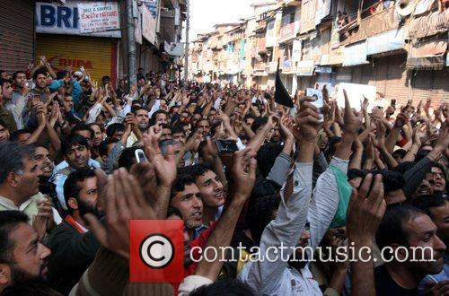 Kashmiri Muslims shout pro freedom slogans during a...