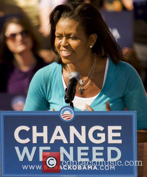 Michelle Obama speaks at a rally in support...