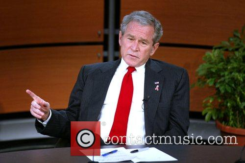 President George W. Bush  is presented with...
