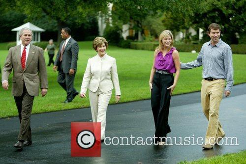US President George W. Bush walks with his...