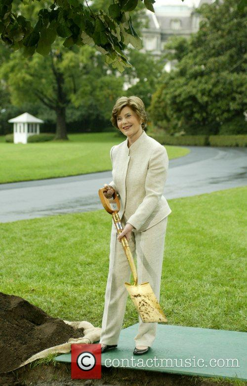 First Lady Laura Bush  holds a shovel...