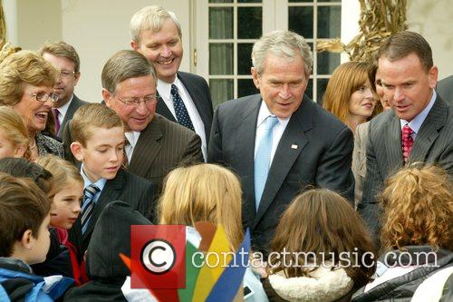 President George W. Bush and turkey farmer Nathan...
