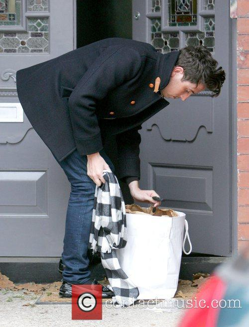 Visits Lily Allen's house carrying a Diesel bag...