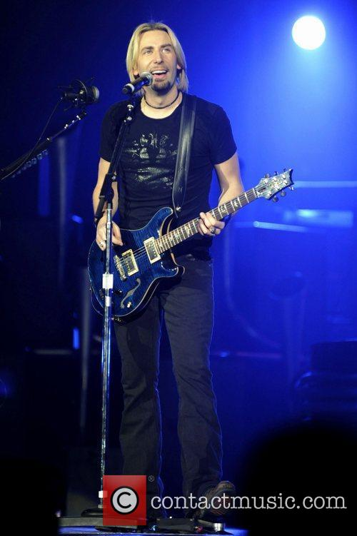 Nickelback performing live on stage at The Air...