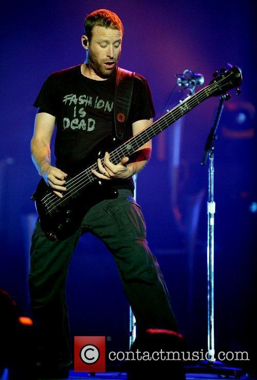 Mike Kroeger Nickelback performing live on stage at...