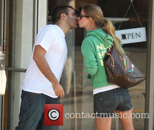 Nicky Hilton kissing David Katzenberg outside Ed's coffee...