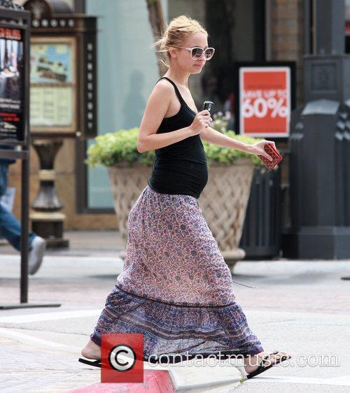 Nicole Richie, wearing a long summer skirt and...