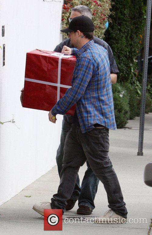 Joel Madden arriving at a baby's party with...