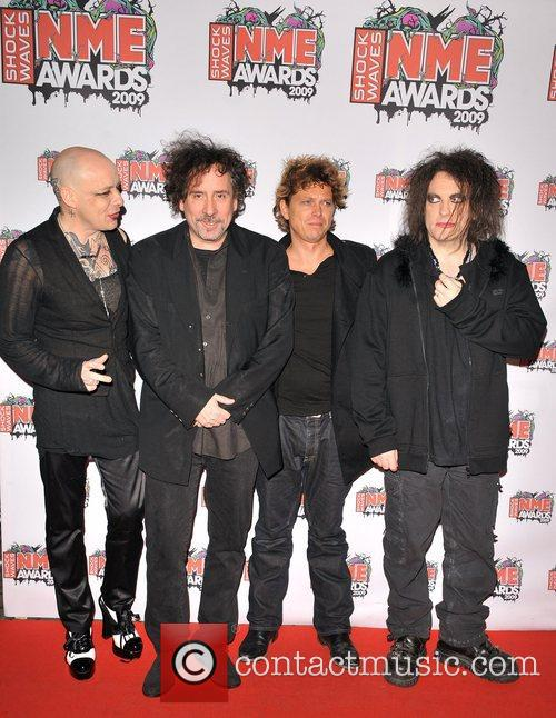The Cure alongside Tim Burton at the 2009 NME awards where they recieved the Godlike Genius award