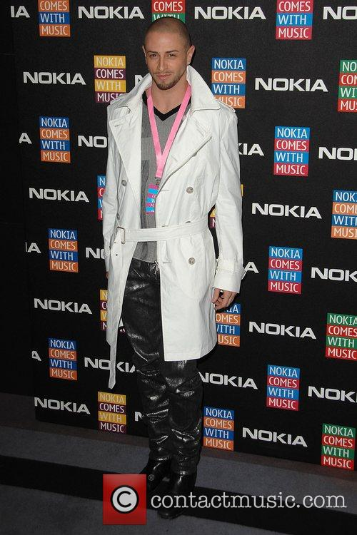 Brian Friedman arrives at the Nokia Comes With...