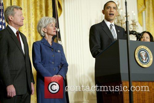 Max Baucus, President Barack Obama and Kansas Governor...
