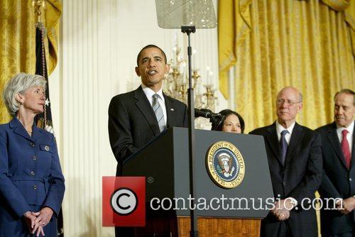 President Barack Obama and Kansas Governor Kathleen Sebelius...
