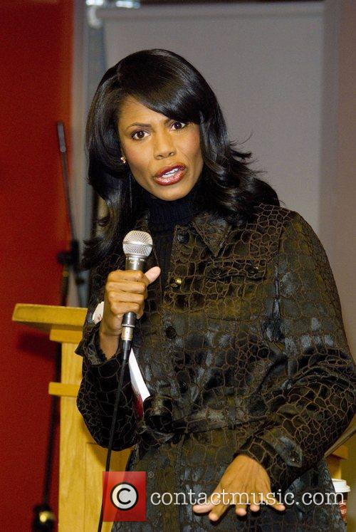 Omarosa signs copies of her book The Bitch...