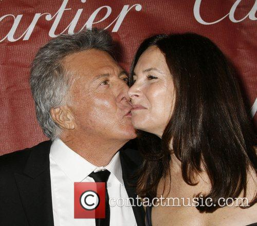 Dustin Hoffman and Guest attends the 2009 Palm...