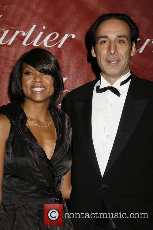Taraji Henson and guest attends the 2009 Palm...