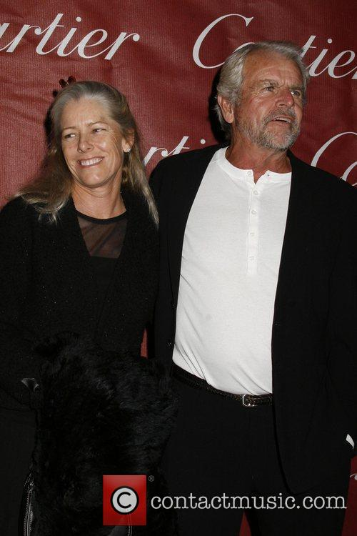William Devane and wife attends the 2009 Palm...