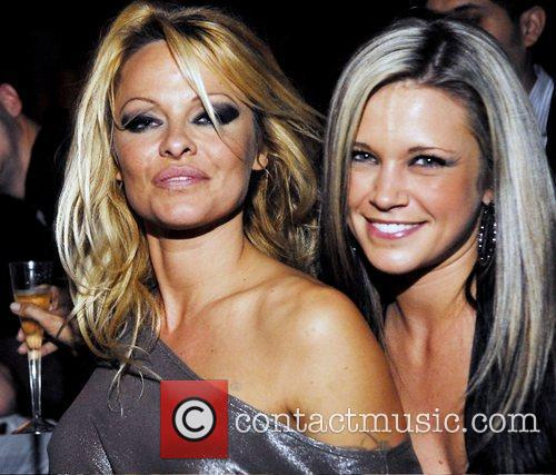 Pamela Anderson parties with fans and friends at...
