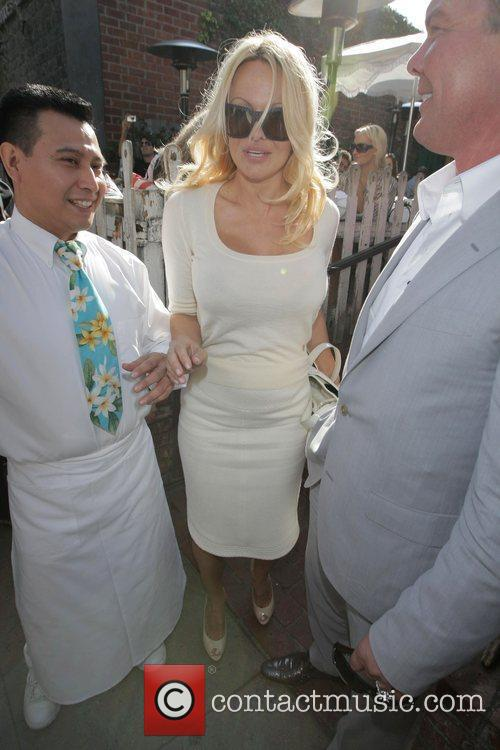 Pamela Anderson and a male friend leave the Ivy after having lunch 13