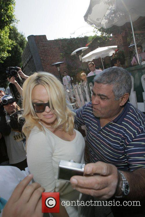 Pamela Anderson and a male friend leave the Ivy after having lunch 12