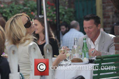 Pamela Anderson and A Male Friend Have Lunch At The Ivy 8