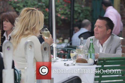 Pamela Anderson and a male friend have lunch at the Ivy 17