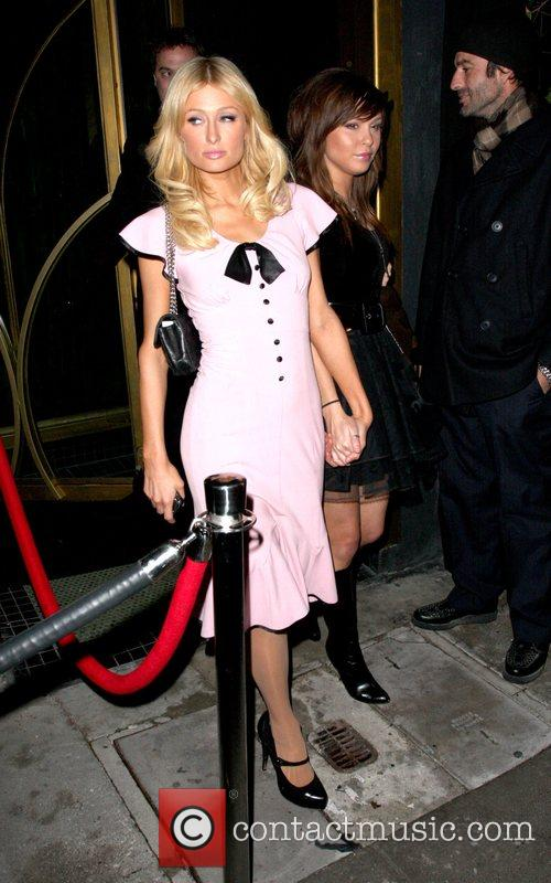 Paris Hilton and her bff Brittany Flickinger leaving...