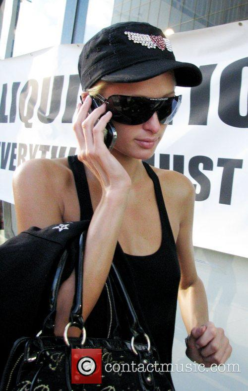Paris Hilton talking on her mobile phone wearing...