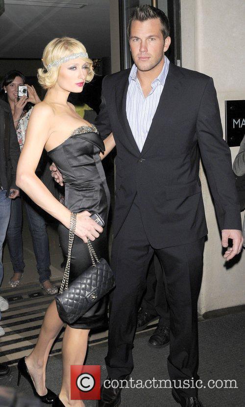 Paris Hilton and boyfriend Doug Reinhardt leaving their...