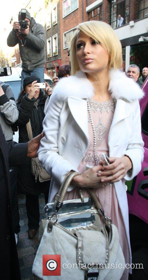 Paris Hilton arriving at her hotel while promoting...